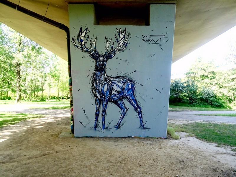 bela-e-animalesca-arte-urbana-de-dzia (18)